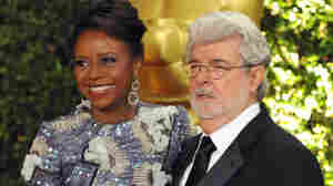 Filmmaker George Lucas and his wife, Chicago native Mellody Hobson, are seen on the red carpet at the 2013 Governors Awards in Los