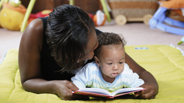 Cuddling up to read a story with the very young helps them recognize words and learn vocabulary, researchers say.