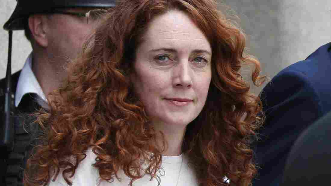 Rebekah Brooks, former News International chief executive, leaves the Central Criminal Court in London on Tuesday, after being acquitted. Former News of the World editor Andy Coulson was convicted of phone hacking Tuesday.