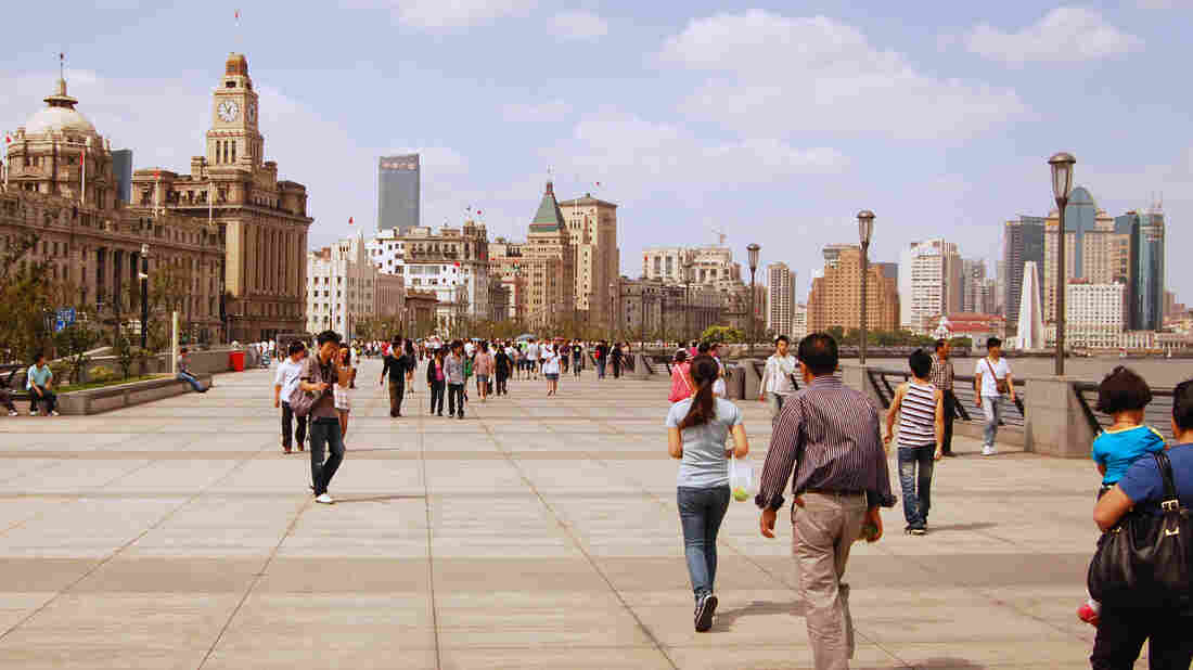 People stroll along the Bund, Shanghai's famed colonial waterfront. Shanghai enjoys considerably better air quality than Beijing, but suffocating pollution last December alarmed residents.