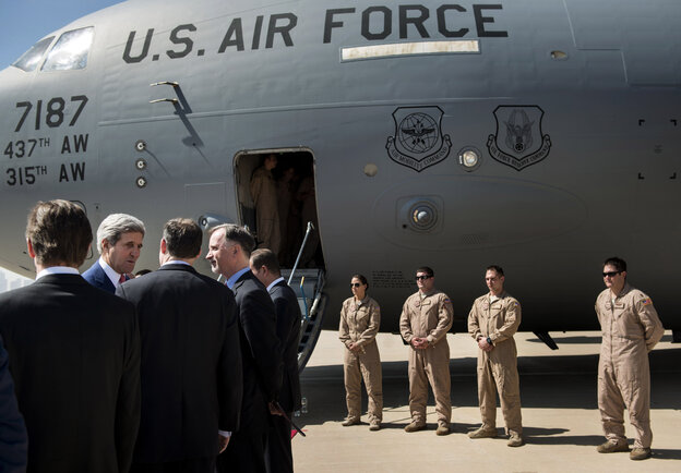 """Secretary of State John Kerry (second from left) arrives at Irbil International Airport with U.S. Ambassador to Iraq Robert Stephen Beecroft (fourth from left) on Tuesday. The president of Iraq's ethnic Kurdish region declared Tuesday that """"we are facing a new reality and a new Iraq."""""""