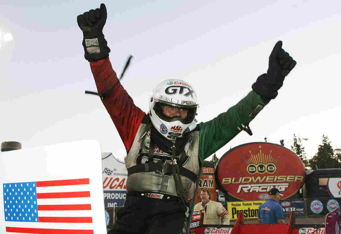 Force climbs out of his car after winning at the 2006 Automobile Club of Southern California NHRA Finals in Pomona, Calif.