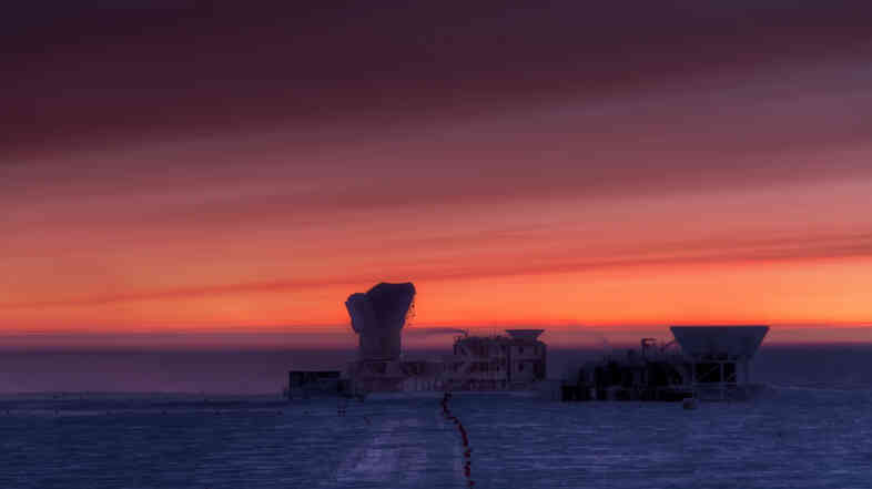 The sun rises behind the cosmic microwave background (CMB) radiation telescopes at the National Science Foundation'€™s South Pole Station.