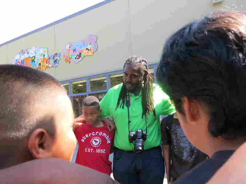 "Ashanti Branch, an assistant principal at Montera Middle School in Oakland, Calif., leads boys in a ""check in"" circle at his after-school Ever Forward Club."