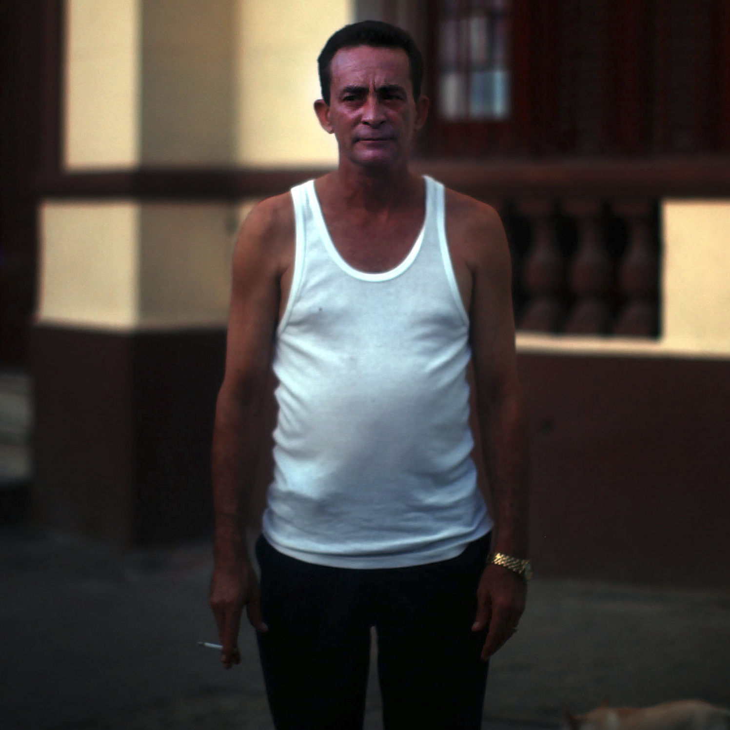 05: Man in white tank top