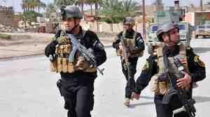 Iraqi members of the Emergency Response Brigade patrol streets in the western city of Ramadi in Anbar province, where government forces are fighting extremist militants, including a force from the Islamic State of Iraq and Syria.