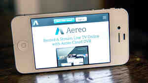Aereo.com, a Web service that provides television shows online, is shown on an iPhone on April 22. The company lost a Supreme Court case Wednesday, as the justices ruled