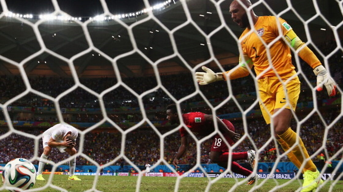 Team USA goalie Tim Howard reacts as Portugal scores its second goal during the 2014 FIFA World Cup match.
