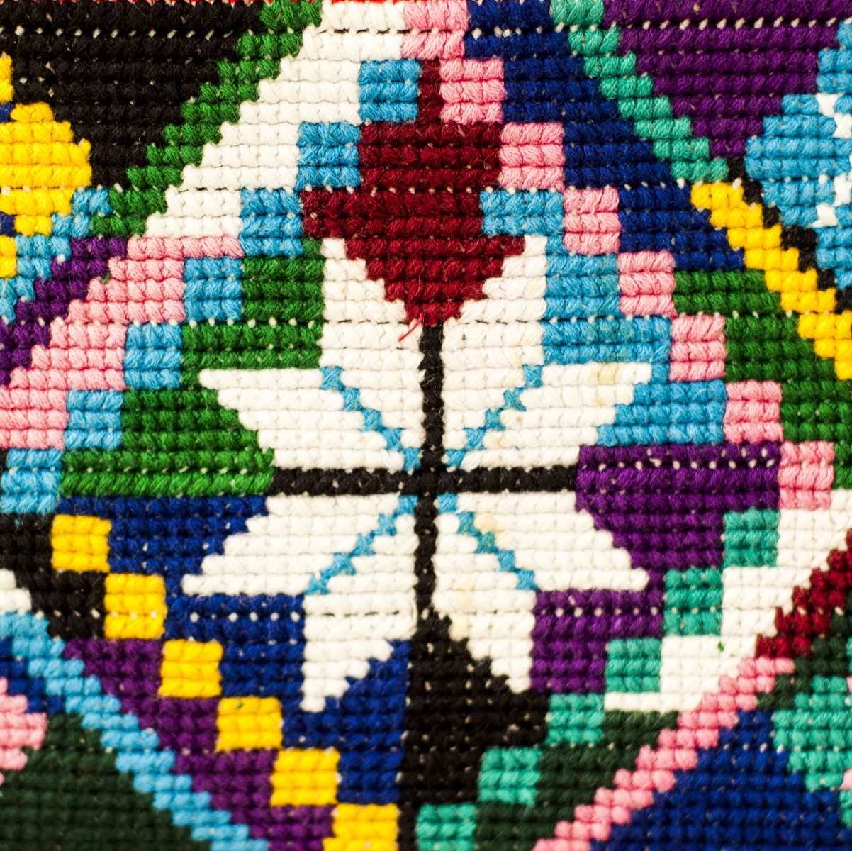 Weavers make huipiles, a detail of which can be seen at right. Huipiles have been worn by indigenous women in Mexico and Central America since before the era of Spanish colonialism.
