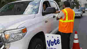 Some voters are a lot more complicated than is commonly understood, a new Pew Research Center study suggests. In Denver, an election worker collects a mail-in ballot from a voter on Tuesday.