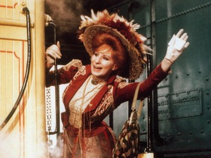 Barbra Streisand does a lot of singing on transit — over the course of Funny Girl, Funny Lady, Yentl and Hello Dolly (above) she sings aboard a train, a plane, a taxi a tugboat, and an ocean liner.