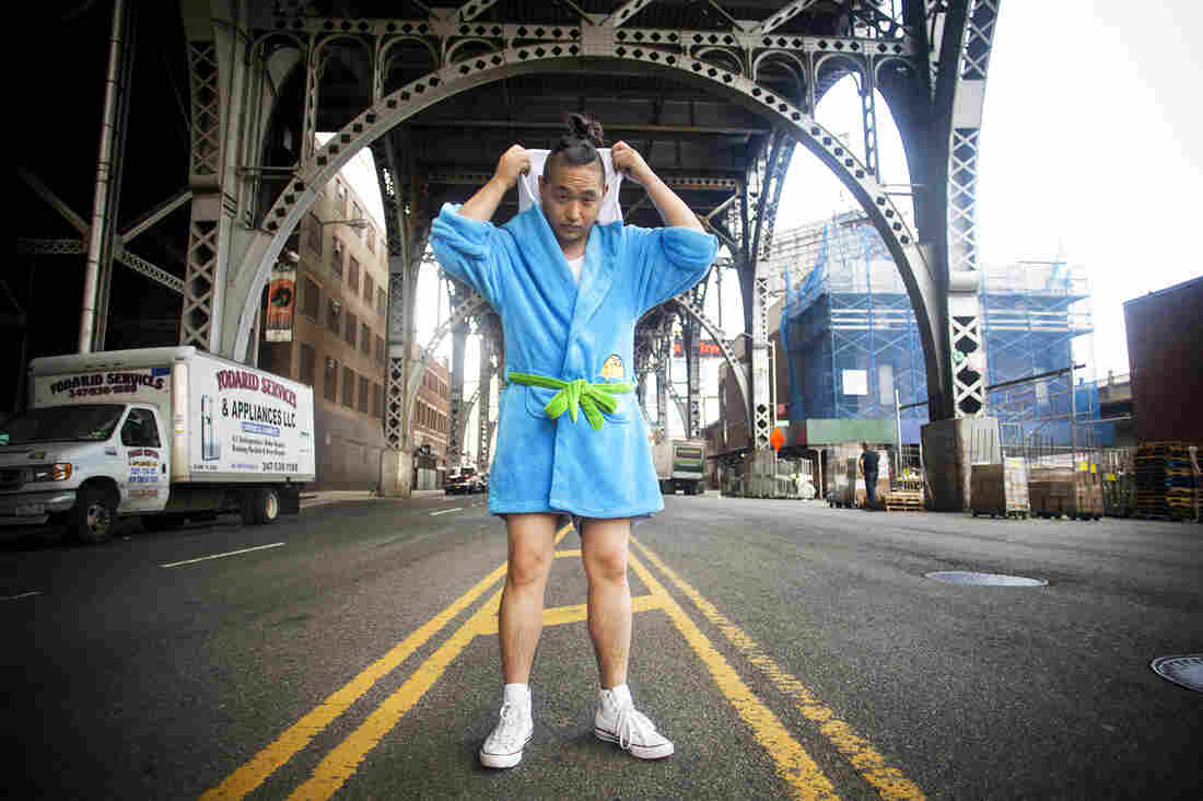 David Lee writes an online men's guide to Asian lifestyle and entertainment. He says he voted against a battle-ax and for his bathrobe when choosing a masculine object. The blue terry cloth robe is based on the Adventure Time cartoon.
