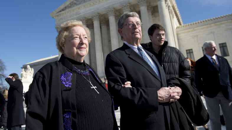 Eleanor McCullen and her attorney, Philip Moran, stand outside the Supreme Court in January after arguments in the case of McCullen v. Coakley.