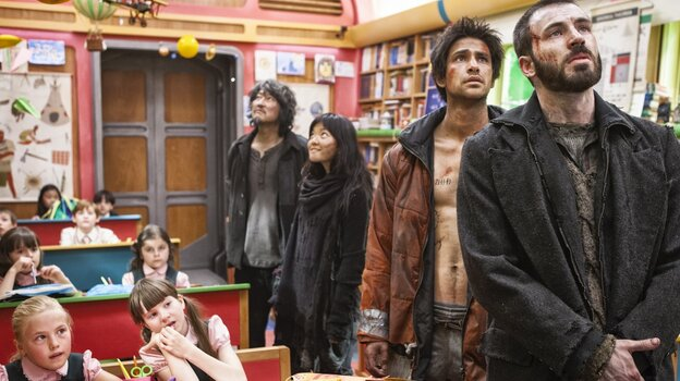 In Snowpiercer, the children of the wealthy who inhabit the front of the train are offered luxuries such as education, while the people who dwell in the train's rear — (from right) Curtis (Chris Evans), Grey (Luke Pasqualino), Yona (Ah-sung Ko) and Namgoong Minsoo (Song Kang-ho) — survive in squalor.