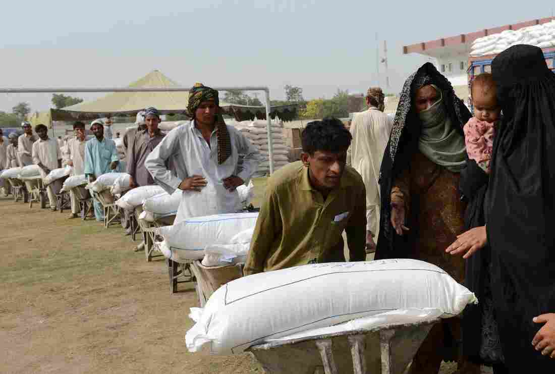 Workers prepare to distribute food Wednesday to civilians fleeing a Pakistan military operation against the Pakistani Taliban in North Waziristan, near the border with Afghanistan. Close to a half-million residents have fled their homes in recent days.