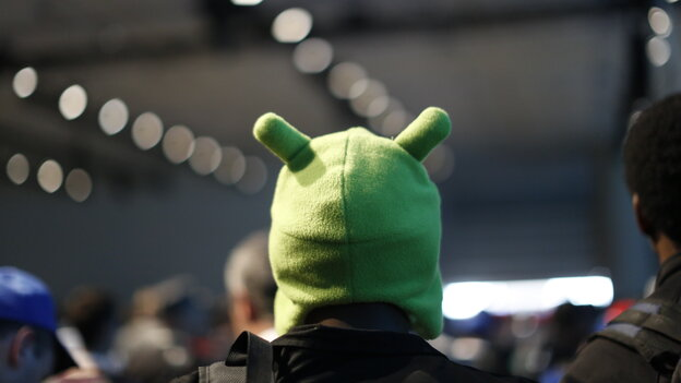 An attendee wears a Google Android Mascot hat during the Google I/O Developers Conference in San Francisco.