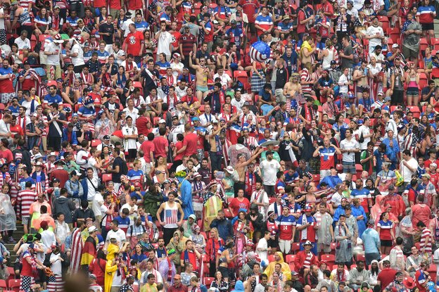 Fans cheer during a World Cup soccer match between the U.S. and Germany at Arena Pernambuco in Recife, Brazil, on Thursday.