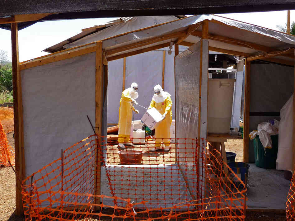 Workers with Doctors Without Borders prepare isolation and treatment areas for Ebola patients in Gueckedou, Guinea.