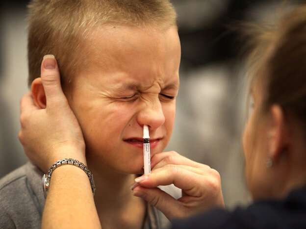 An elementary school student Shane Shorter gets a a dose of FluMist in Gainesville, Fla.