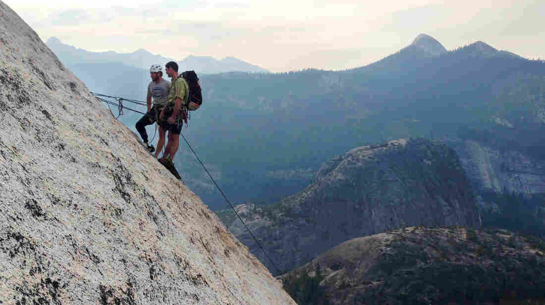 National Guardsman Andrew Sullens (left) climbs Half Dome in Yosemite National Park, Calif., with Pat Warren, lead climber from Paradox Sports. Sullens, who lost his leg below the knee while serving in Kapisa province, Afghanistan, participated in the three day climb with other veterans to honor the anniversary of September 11th.