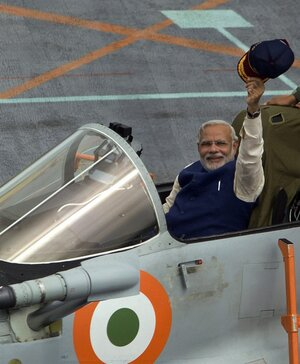India's Prime Minister Narendra Modi waves from a MIG 29 fighter aboard the country's largest warship, INS Vikramaditya, off the coast of Goa, India, on June 14.