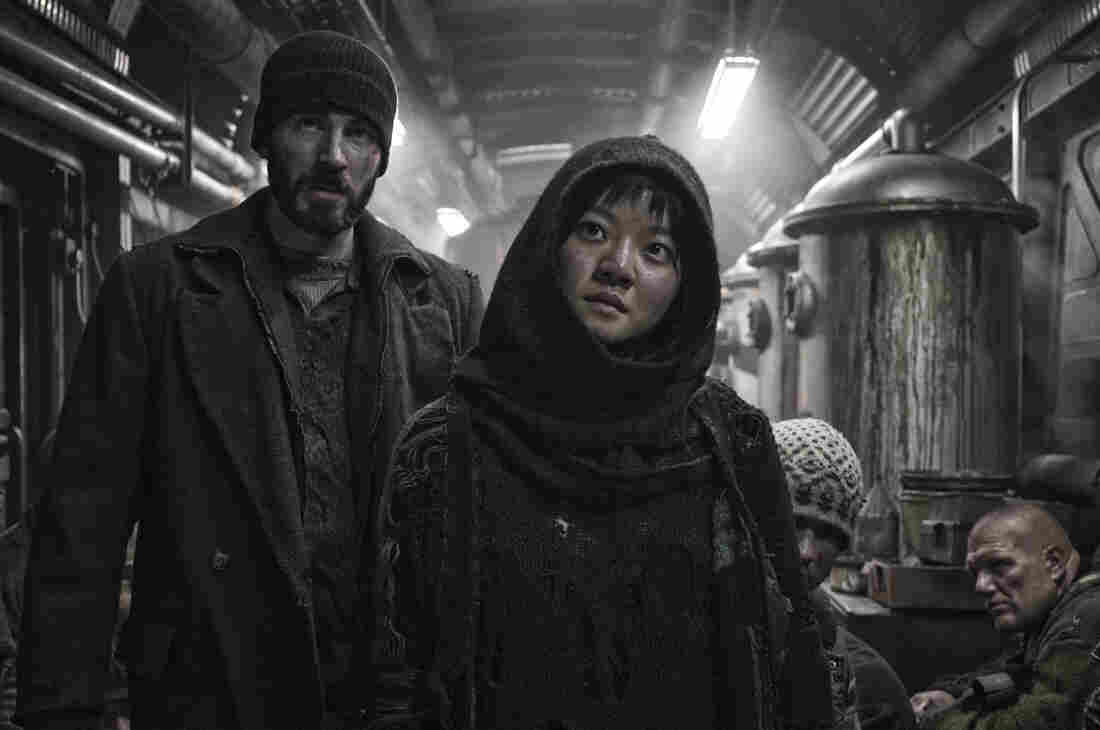 """In Snowpiercer, Curtis (Chris Evans) and Yona (Ah-sung Ko) are trying to fight their way to the front of a train that is cruelly class segregated. """"[It's] similar to Occupy Wall Street in terms of the 99 percent versus the 1 percent,"""" says South Korean director Bong Joon-ho. """"That's something that happens in other countries and also in Korea."""""""