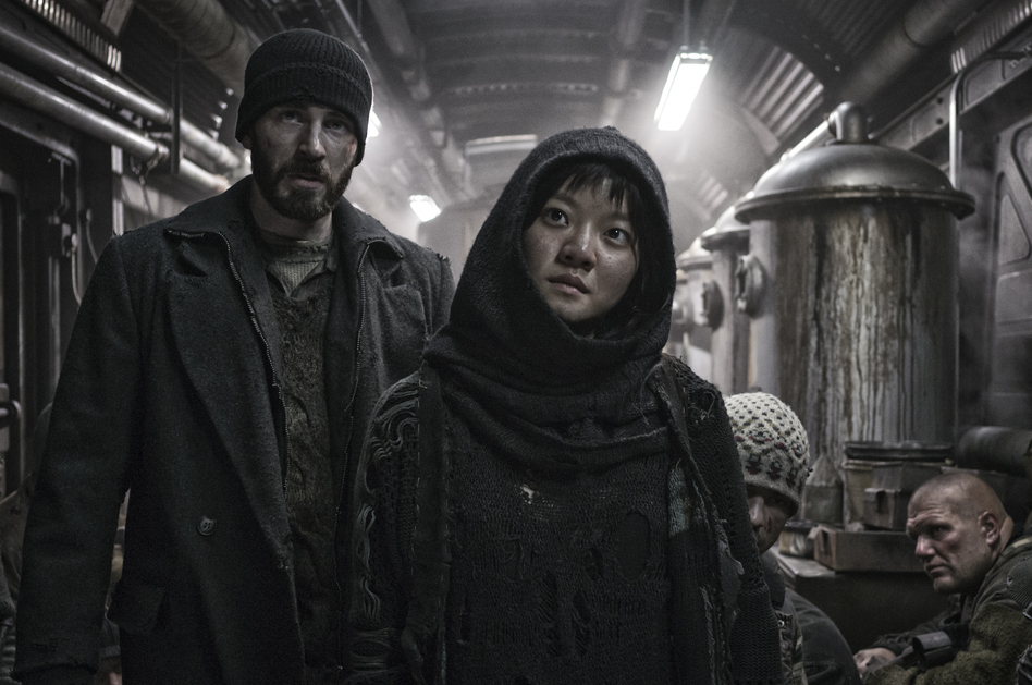 """In <em>Snowpiercer,</em> Curtis (Chris Evans) and Yona (Ah-sung Ko) are trying to fight their way to the front of a train that is cruelly class segregated. """"[It's] similar to Occupy Wall Street in terms of the 99 percent versus the 1 percent,"""" says South Korean director Bong Joon-ho. """"That's something that happens in other countries and also in Korea."""" (Radius TWC)"""