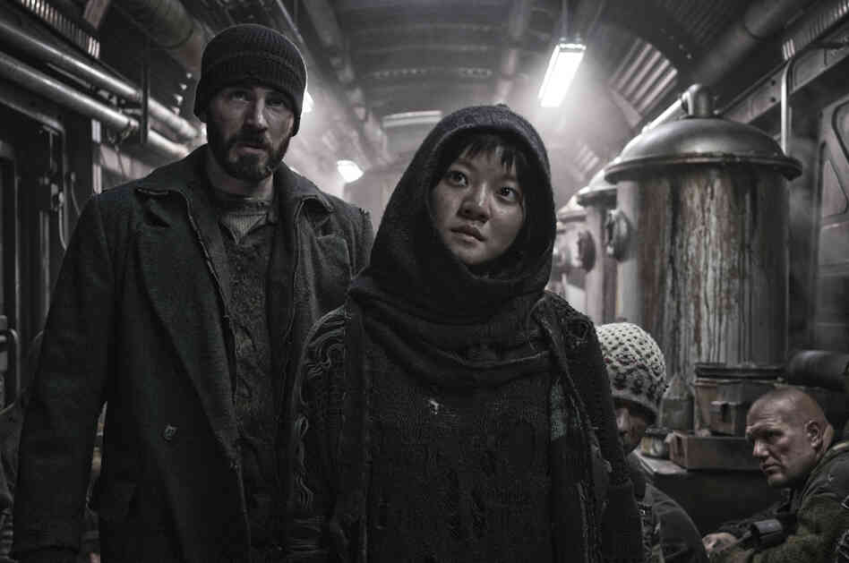"In Snowpiercer, Curtis (Chris Evans) and Yona (Ah-sung Ko) are trying to fight their way to the front of a train that is cruelly class segregated. ""[It's] similar to Occupy Wall Street in terms of the 99 percent versus the one percent,"" says South Korean director Bong Joon-ho. ""That's something that happens in other countries and also in Korea."""