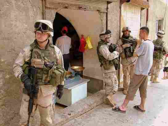Sergeant Jason Hansman, left, on patrol in Mosul, Iraq. He was deployed there from 2004 to 2005; now, Hansman works for the Iraq and Afghanistan Veterans of America, helping to support fellow vets.