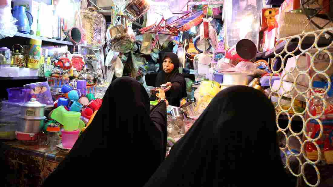 Iraqis shop for food in preparation for the Muslim fasting month of Ramadan in Baghdad on Saturday.