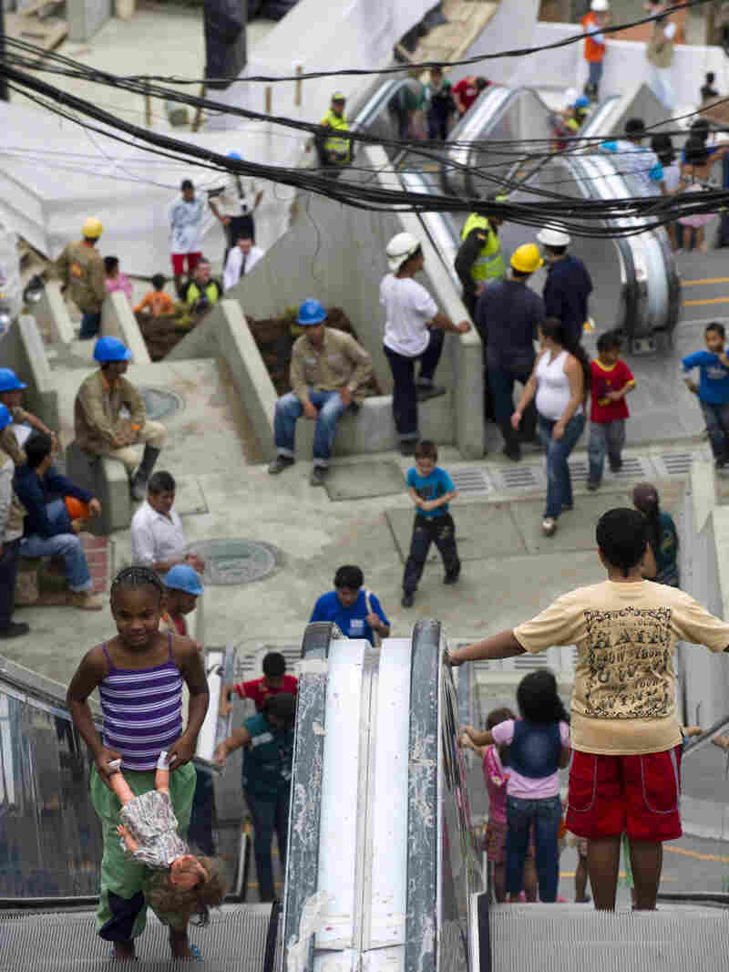 The 1,300-foot escalator linking hillside shanties with the city's commercial center is a living  metaphor, linking the poor to economic opportunity.