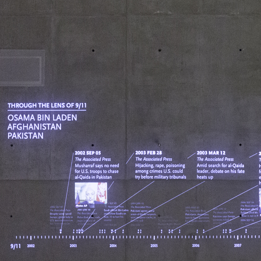 """Timescape"" selects headlines from prominent English-language news sources, from Sept. 11, 2001, through today, and projects them onto a concrete wall."