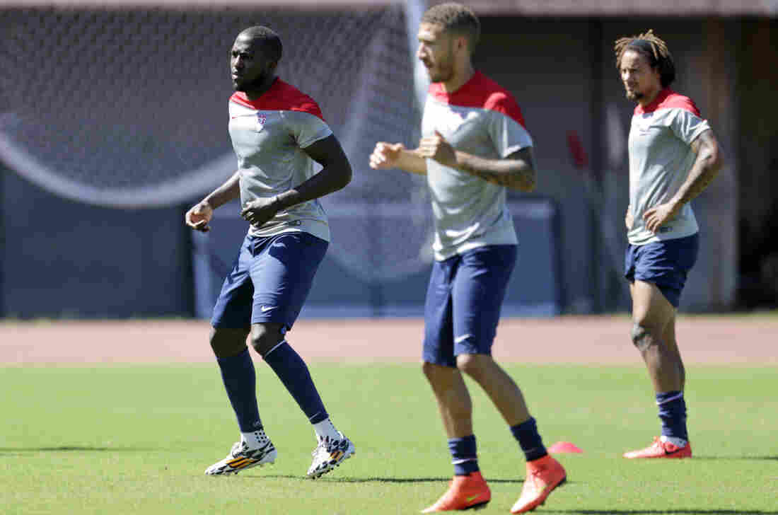 U.S. striker Jozy Altidore (left) works out with Fabian Johnson (center) and Jermaine Jones  during a World Cup training session in Salvador, Brazil, Monday. The U.S. says Altidore is fit to play against Belgium in their elimination matchup Tuesday.