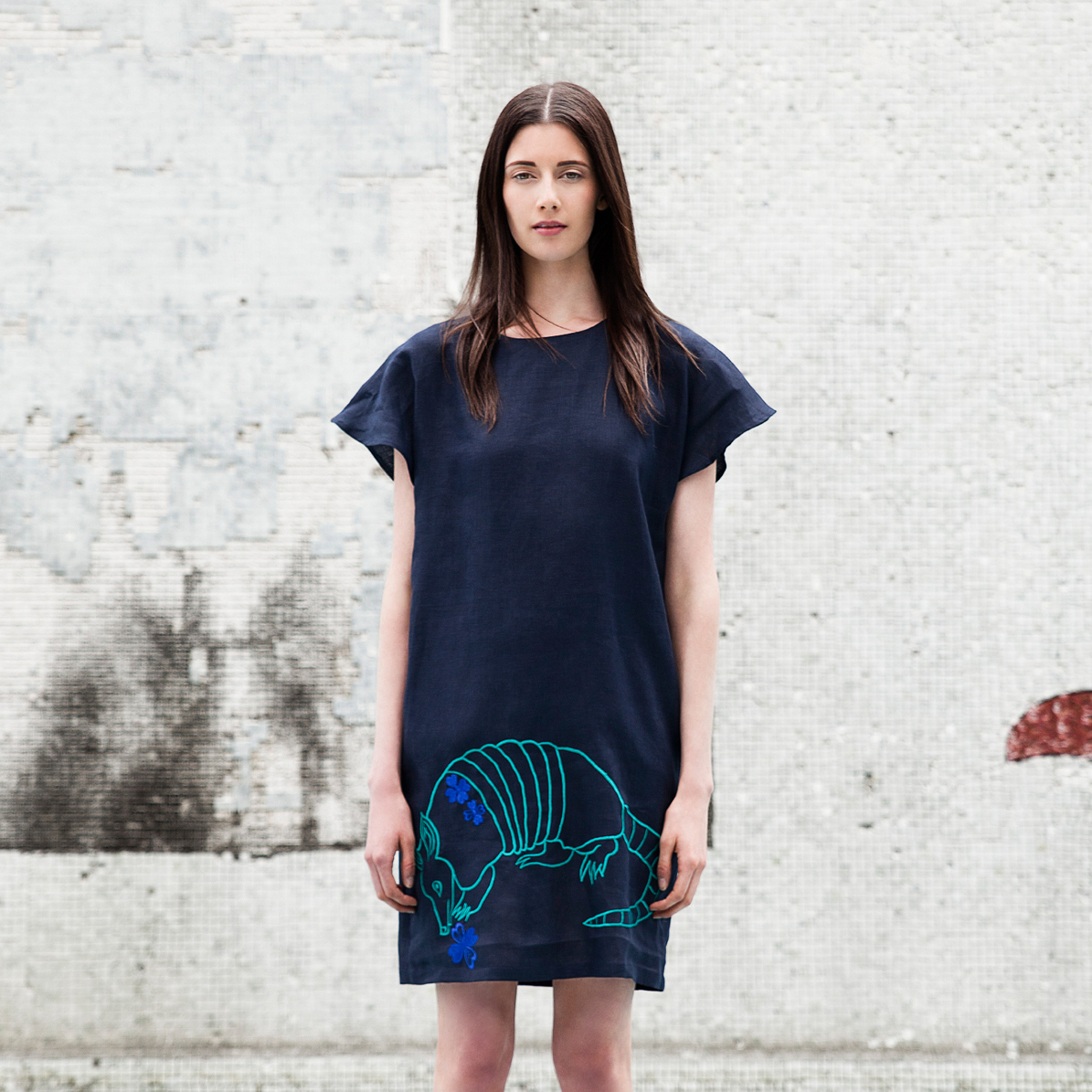 Mayan artisans hand-embroidered an armadillo onto this linen dress from Carla Fernández's Mayalands collection. The shape of Fernández's dress is inspired by the traditional huipil,although the rest of the design is unrelated.