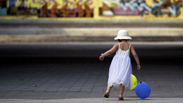 A child plays in a Beijing park. Health threats caused by pollution have become a major conc