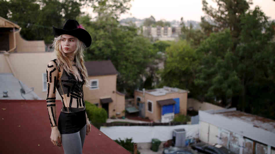 A new track by Grimes is featured on this week's mix.