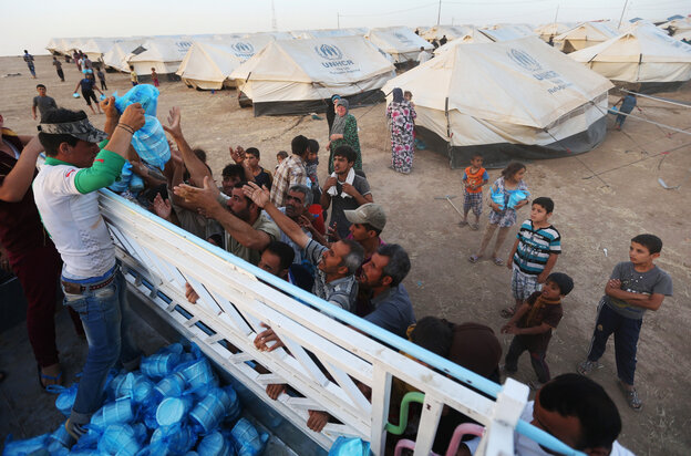 Displaced Iraqi citizens receive meals to break their Ramadan fast from a Kurdish charity group. Iraq's central government has launched its first major operation against the ISIS insurgent group.