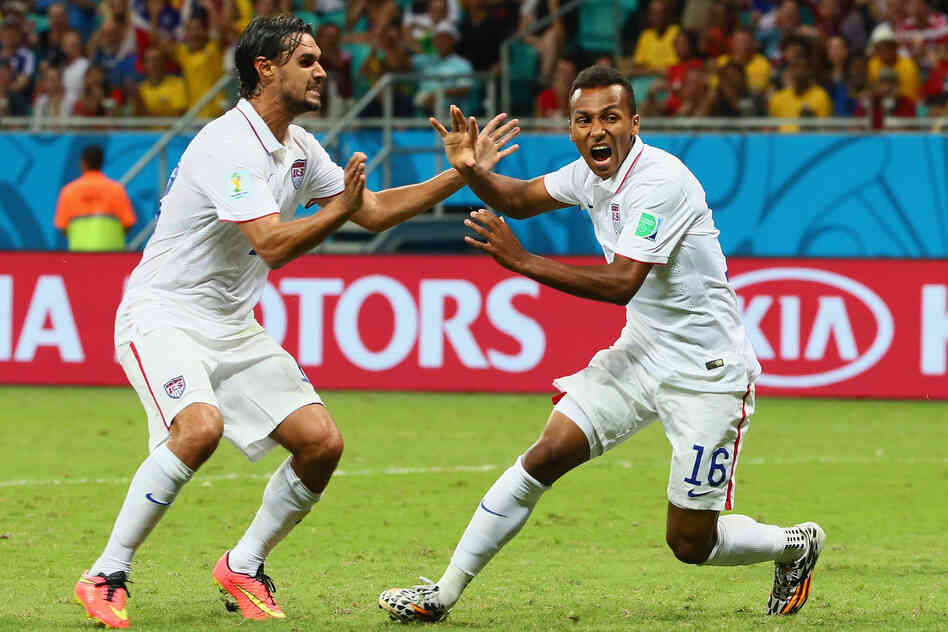 Julian Green of the United States (right) celebrates scoring his team's first goal in extra time with Chris Wondolowski.