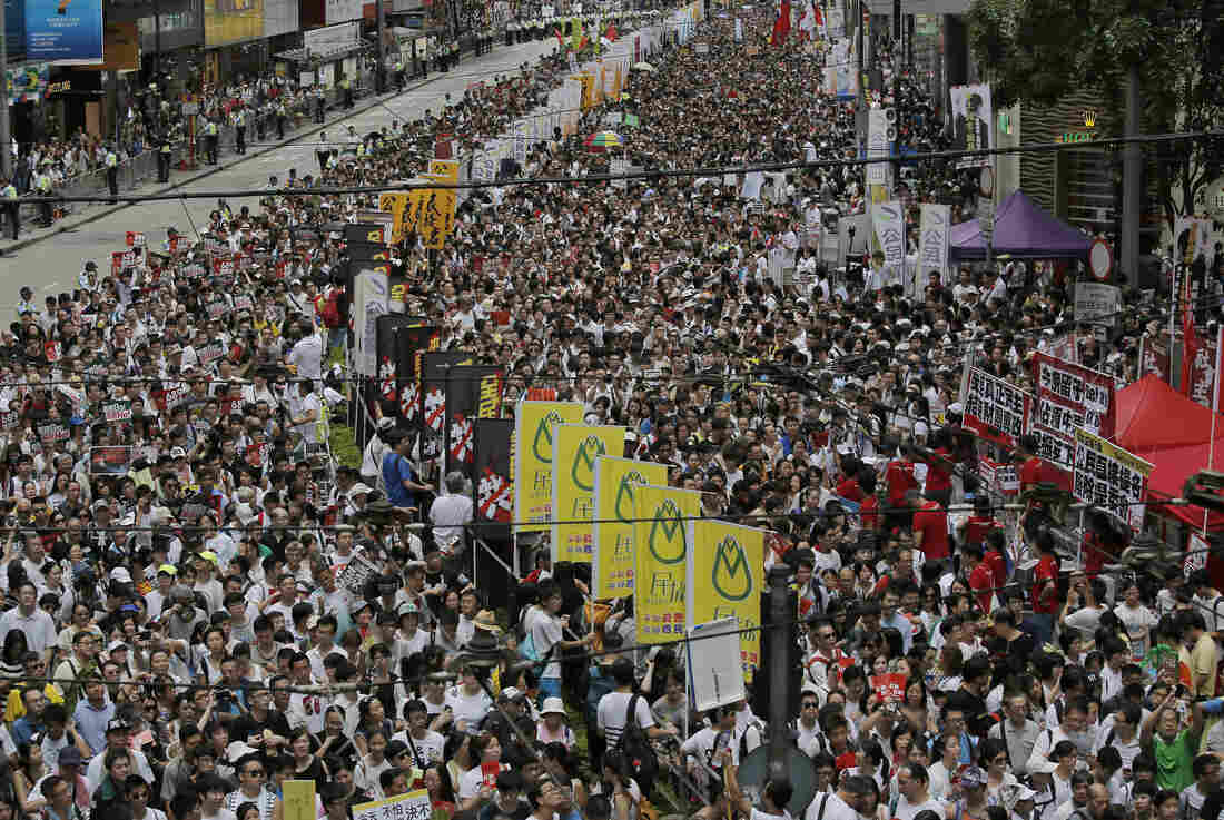 Tens of thousands of people march Tuesday in downtown Hong Kong during an annual protest pushing for greater autonomy.