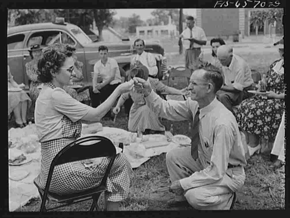 In this undated photo, a couple breaks a wishbone at a picnic during the Cotton Festival in Hayti, Mo.
