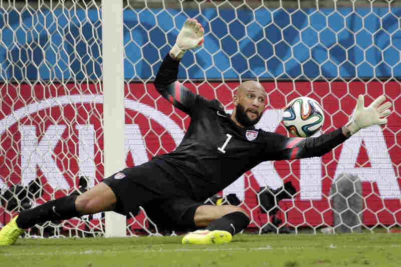 United States' goalkeeper Tim Howard stops a shot by Belgium.