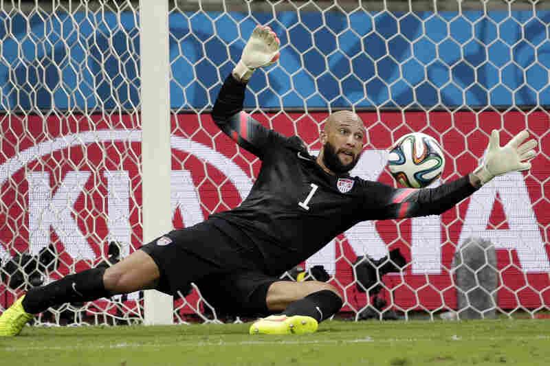 United States' goalkeeper Tim Howard stops a shot by Belgium.