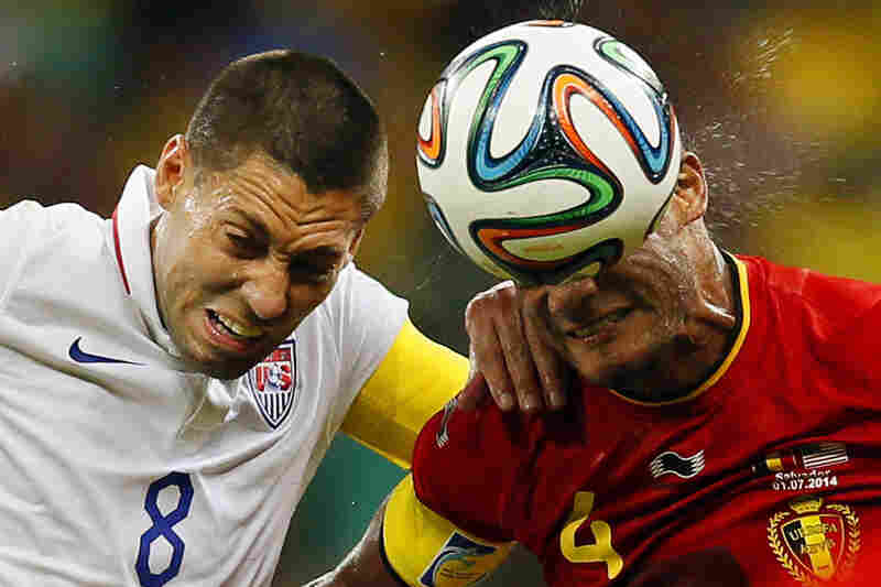 United States' Clint Dempsey (left) and Belgium's Vincent Kompany battle for the ball during the match.
