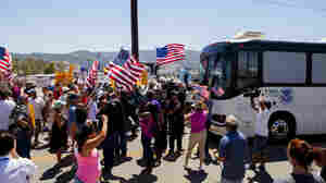 Protesters block the arrival of immigrant detainees who were scheduled to be processed at the Murrieta Border Patrol station in California on Tuesday.