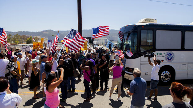 Protesters block the arrival of immigrant detainees who were scheduled to be processed at the Murrieta Border Patr