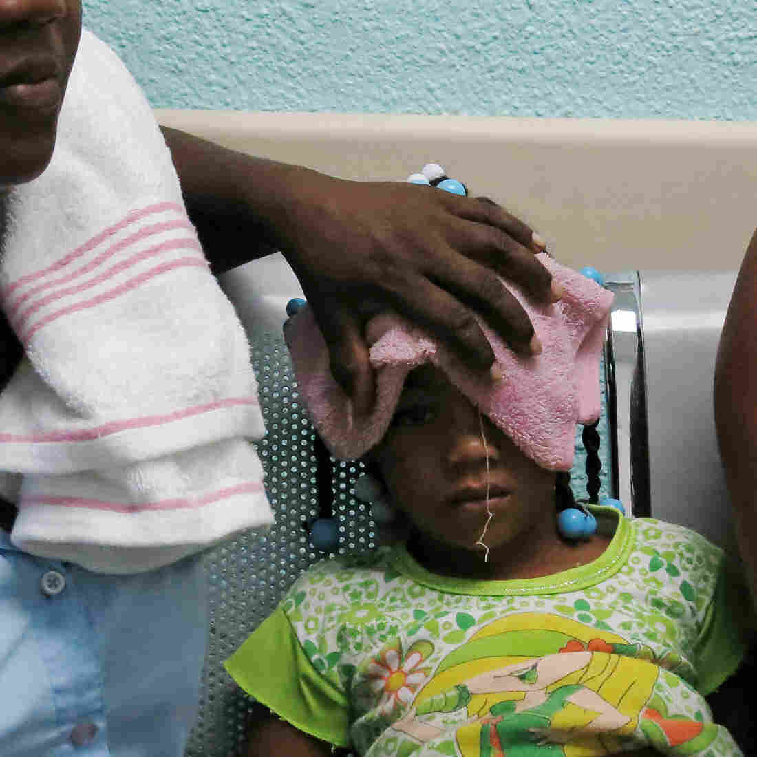 Sick with chikungunya, Karla Sepulveda, 5, waits in a public hospital with her grandmother in Boca Chica, Dominican Republic, on May 15. The Caribbean nation has reported more than 100,000 cases this year.