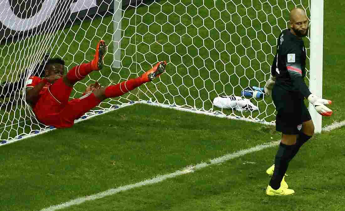No Score: Belgium's Divock Origi throws himself into the net behind goalkeeper Tim Howard of the U.S. during Tuesday's World Cup Round of 16 game.
