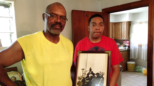 Steven Clark says even though he's learned plenty from his teachers at Urban Prep, his father, Allen, is his biggest role model. The family has a personal connection to civil rights history: Allen holds a picture that shows his cousin, gospel singer Mahalia Jackson, singing at the Lincoln Memorial during the 1963 March on Washington.