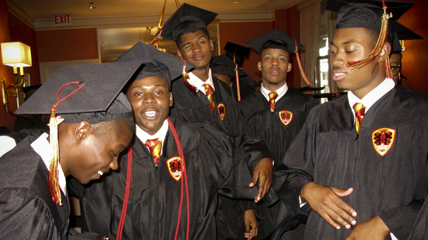 In one of the waiting rooms of the Chicago Civic Opera House, Urban Prep graduates dance and let off some steam before the school's commencement ceremony begins. (Cheryl Corley/NPR)