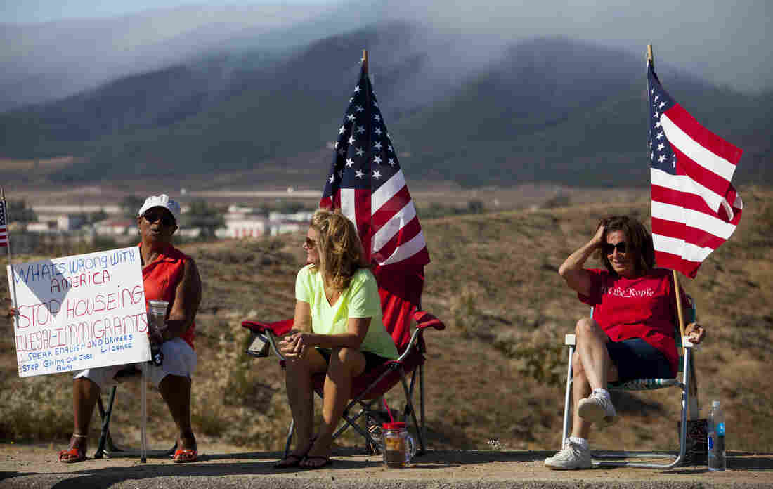 Demonstrators picket the pending arrival of undocumented immigrants who were to be processed at the Murrieta Border Patrol station.
